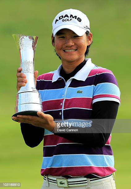 Yani Tseng of Taiwan poses with the trophy after claiming a 1 stroke victory during the final round of the 2010 Ricoh Women's British Open at Royal...