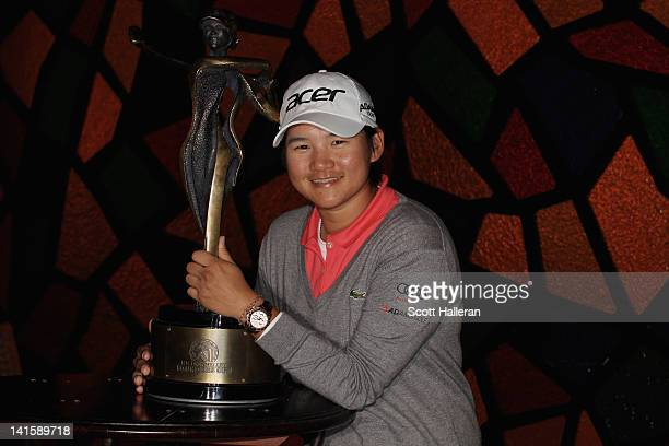 Yani Tseng of Taiwan poses with the trophy after winning the RR Donnelley LPGA Founders Cup at the JW Marriott Desert Ridge Resort Spa on March 18...