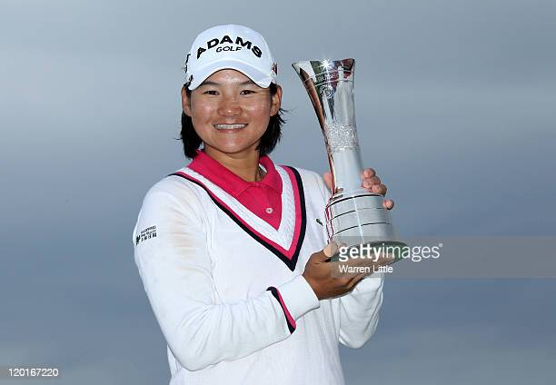 Yani Tseng of Taiwan poses with the trophy following her victory at the end of the final round of the 2011 Ricoh Women's British Open at Carnoustie...