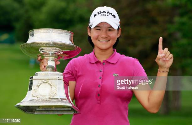 Yani Tseng of Taiwan poses with the winner's trophy after her tenstroke victory at the Wegmans LPGA Championship at Locust Hill Country Club on June...