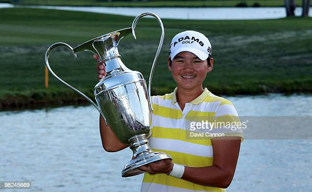 Yani Tseng of Taiwan proudly holds the trophy after her one shot victory in the 2010 Kraft Nabisco Championship on the Dinah Shore Course at The...