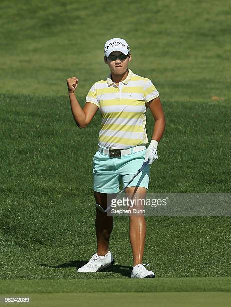 Yani Tseng of Taiwan pumps her fist after chipping for an eagle on the dsecond hole during the final round of the Kraft Nabisco Championship at...
