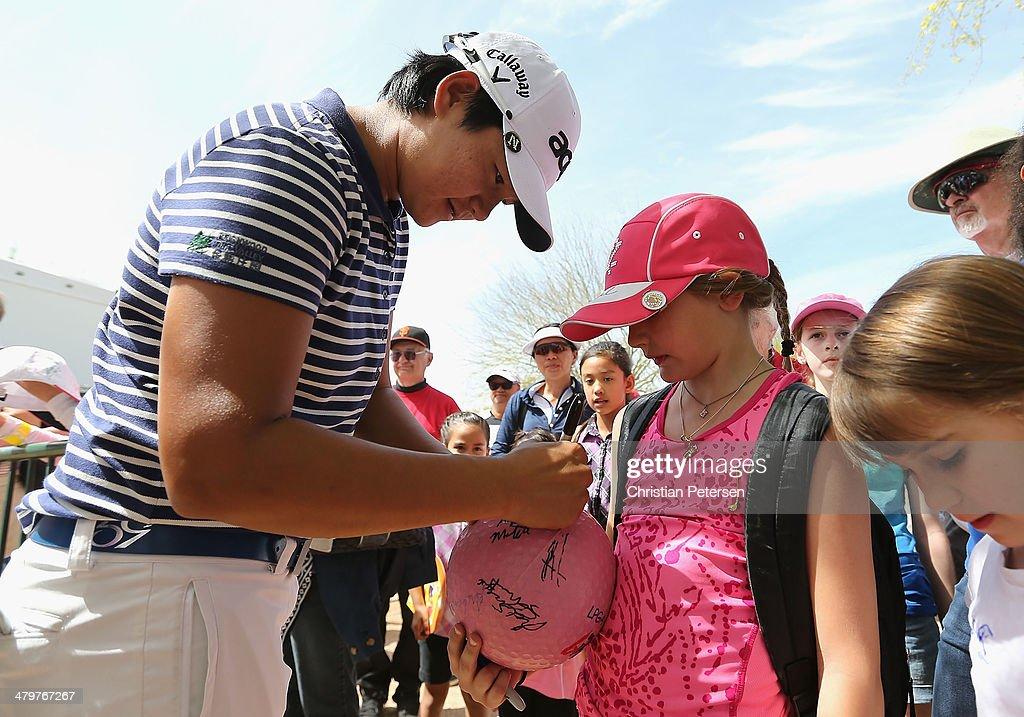 Yani Tseng of Taiwan signs autographs for young fans following the first round of the JTBC LPGA Founders Cup at Wildfire Golf Club on March 20, 2014 in Phoenix, Arizona.