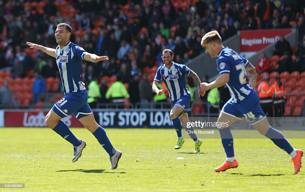 Yanic Wildschut of Wigan Athletic (31) celebrates with team mates as he scores their third goal during the Sky Bet League One match between Blackpool and Wigan Athletic at Bloomfield Road on April 30, 2016 in Blackpool, England.