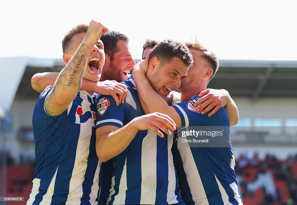 Yanic Wildschut of Wigan Athletic (C) celebrates with team mates as he scores their third goal during the Sky Bet League One match between Blackpool and Wigan Athletic at Bloomfield Road on April 30, 2016 in Blackpool, England.