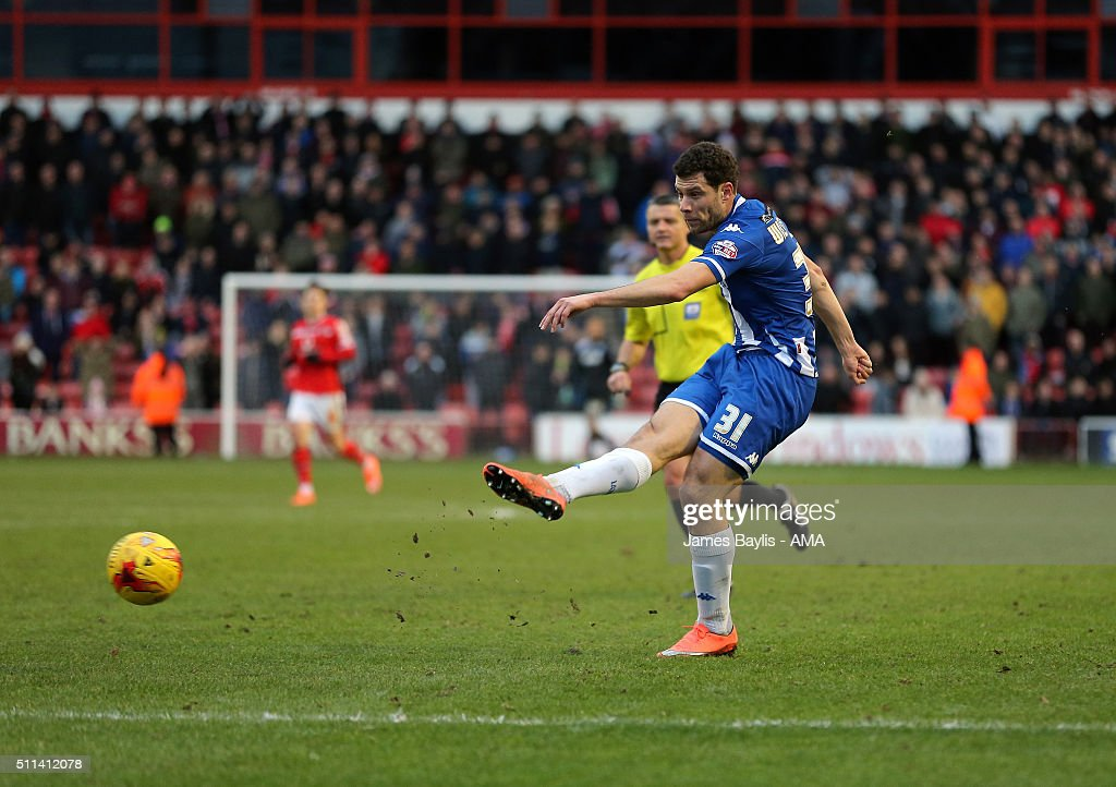 Yanic Wildschut of Wigan Athletic scores a goal to make it 1-2 during the Sky Bet League One match between Walsall and Wigan Athletic at Bescot Stadium on February 20, 2016 in Walsall, England.