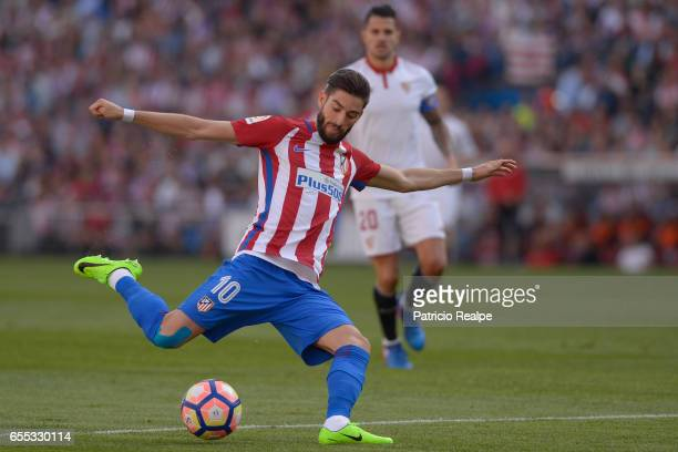 Yanick Carrasco of Atletico de Madrid kicks the ball during the La Liga match between Club Atletico de Madrid and Sevilla FC at Vicente Calderon...