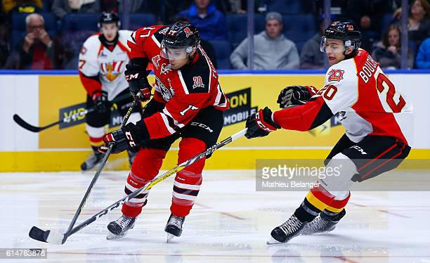Yanick Turcotte of the Quebec Remparts and Xavier Bouchard of the Baie Comeau Drakkar battle for the puck during their QMJHL hockey game at the...