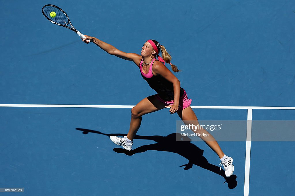 Yanina Wickmayer of Belarus plays a forehand in her third round match against Maria Kirilenko of Russia during day six of the 2013 Australian Open at Melbourne Park on January 19, 2013 in Melbourne, Australia.