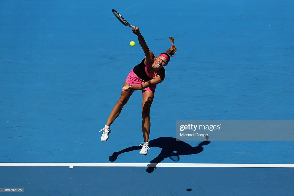 Yanina Wickmayer of Belarus serves in her third round match against Maria Kirilenko of Russia during day six of the 2013 Australian Open at Melbourne Park on January 19, 2013 in Melbourne, Australia.