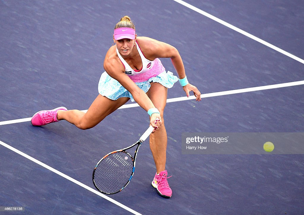 Yanina Wickmayer of Belgium plays a volley in her match against Maria Sharapova of Russia during the BNP Parisbas Open at the Indian Wells Tennis...