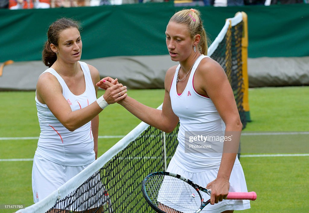 <a gi-track='captionPersonalityLinkClicked' href=/galleries/search?phrase=Yanina+Wickmayer&family=editorial&specificpeople=5406363 ng-click='$event.stopPropagation()'>Yanina Wickmayer</a> of Belgium (R) shakes hands with <a gi-track='captionPersonalityLinkClicked' href=/galleries/search?phrase=Vesna+Dolonc&family=editorial&specificpeople=4872668 ng-click='$event.stopPropagation()'>Vesna Dolonc</a> of Serbia after losing her Ladies's Singles first round match on day one of the Wimbledon Lawn Tennis Championships at the All England Lawn Tennis and Croquet Club on June 24, 2013 in London, England.