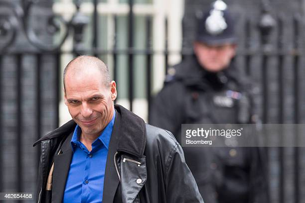 Yanis Varoufakis Greece's finance minister left passes a police officer as he arrives for his meeting with George Osborne UK chancellor of the...