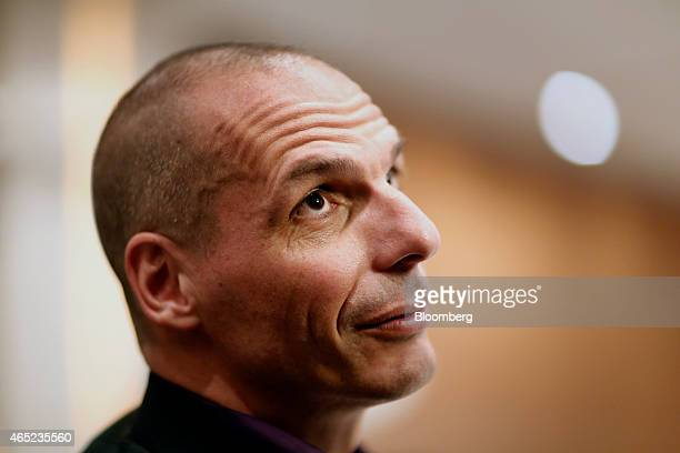 Yanis Varoufakis Greece's finance minister pauses while speaking during a business conference held at the Hilton Hotel in Athens Greece on Wednesday...