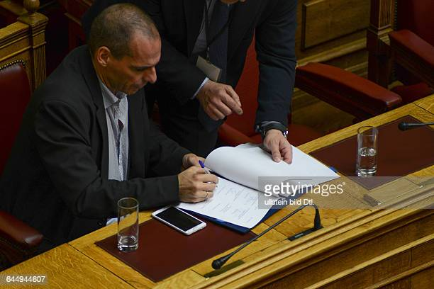 Yanis Varoufakis Minister of Finance signing a law