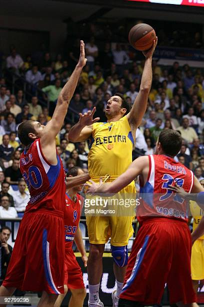 Yaniv Green of Maccabi Electra competes with Dmitry Sokolov of CSKA Moscow and Viktor Khryapa of CSKA Moscow in action during the Euroleague...