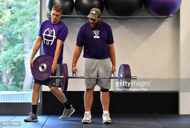 Yaniv Kovalski of Jerusalem Israel holds a barbell as quarterback Matt Foltz of Mt Joy PA adds weight as they work out with teammates in the athletic...