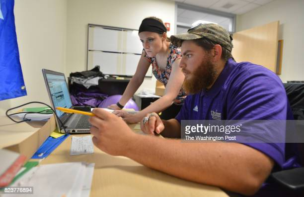 Yaniv Kovalski of Jerusalem Israel right with Courtney Osier Recreational Sports Manager during his summer office job in the athletic department at...
