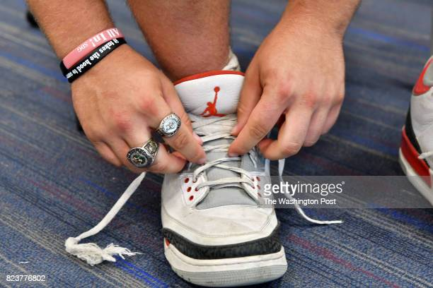 Yaniv Kovalski wears a pair of championship rings from the Israeli Football league as he ties his sneakers before a workout at Stonehill College in...