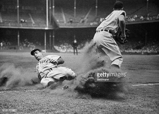 Yankee Joe DiMaggio is out at third in the second inning of the game with Tigers at Briggs Stadium in Detroit Tiger third baseman George Kell has the...