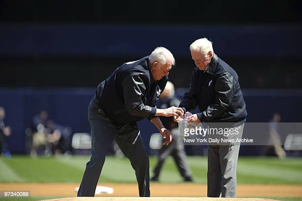 Yankee legends Don Larsen and Whitey Ford get the dirt on new Stadium as they collect piece of mound during pregame ceremonies highlighted by jets...