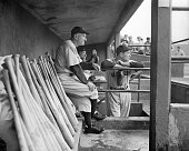 Yankee manager Casey Stengel and pitcher Joe Page watch the rainfall that dropped them another halfgame in the torrid American League pennant fight...
