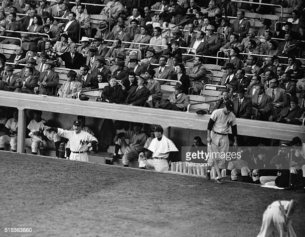 Yankee manager Casey Stengel dramatically points at the scoreboard at Yankee Stadium as five big runs go up for the Boston Red Sox in their game with...