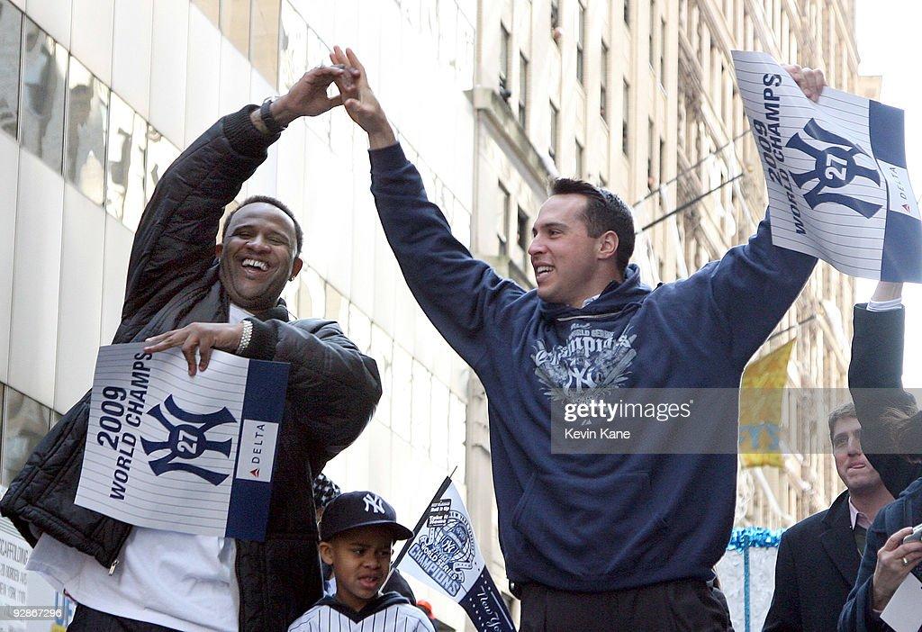 Yankee pitcher CC Sabathia and Yankee first baseman Mark Teixeira celebrate duing the 2009 New York Yankees World Series Victory Parade on November 6...