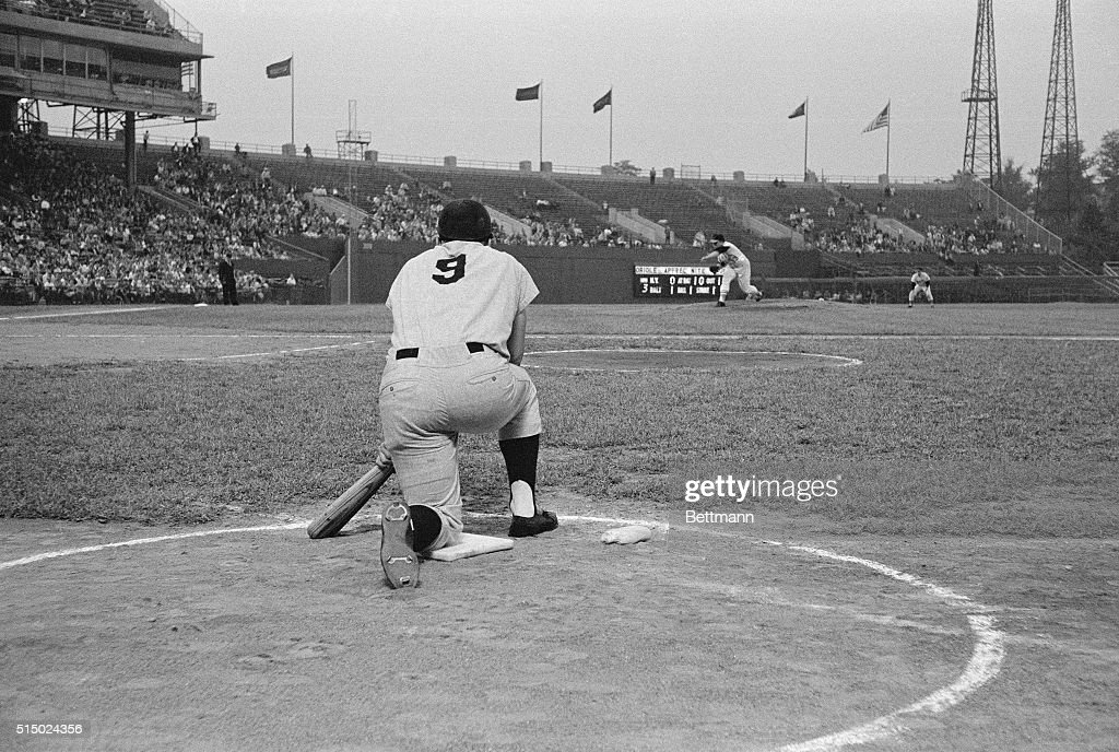 Yankee slugger Roger Maris in the on deck circle watches as Orioles Steve Barber pitches to Tony Kuback in the 8th inning of first game of double...