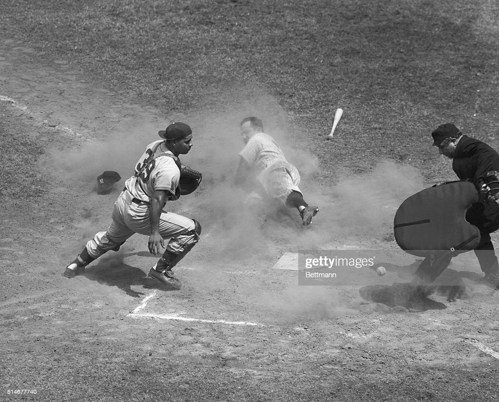 Yankees catcher Yogi Berra slides into home after Ferris Fain tripled, during the second inning of the 1951 All-Star Game. Dodgers catcher Roy Campanella chases the loose ball.