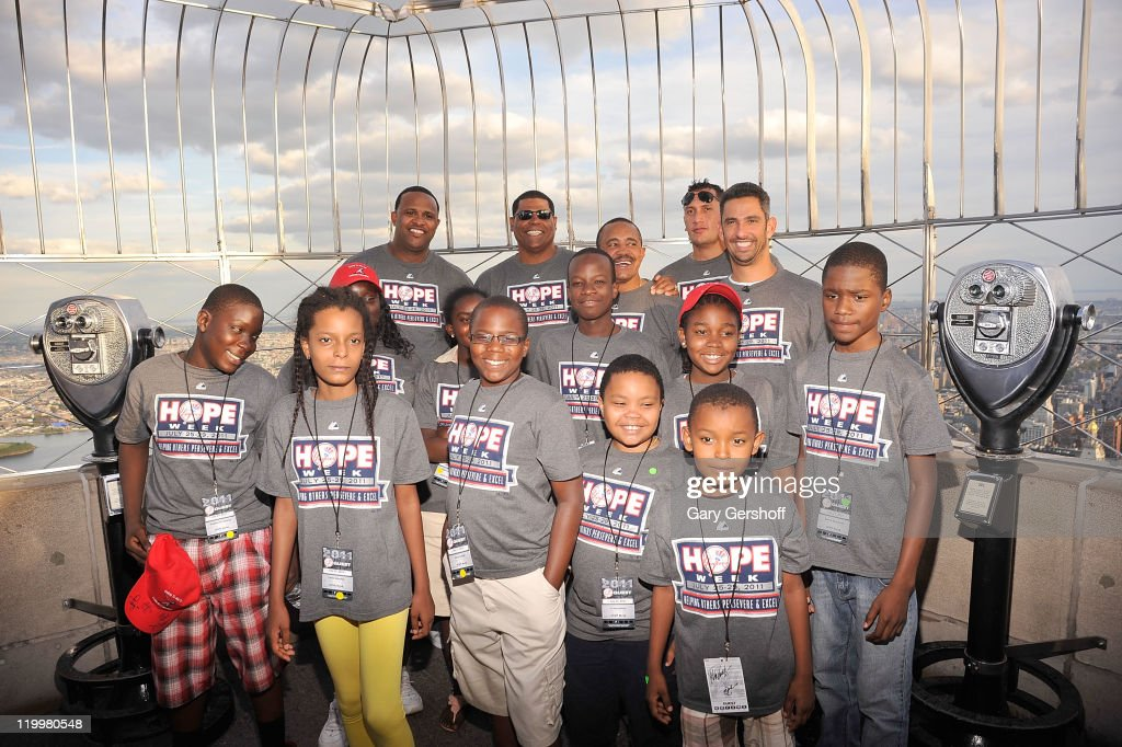 N.Y. Yankees CC Sabathia, Mike Harkey, Tony Pena, Freddy Garcia, and Jorge Posada, along with Haitian school children fron the Ss. Joachim and Anne's School of Queens attend the New York Yankees Stars Tour of NYC during HOPE Week 2011 on the Observation Deck of The Empire State Building on July 27, 2011 in New York City.