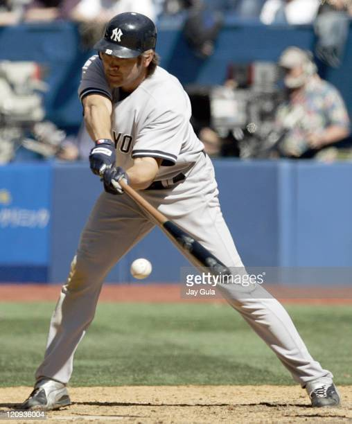 NYY Yankees CF Johnny Damon lunges at and fouls off a pitch during the New York Yankees vs Toronto Blue Jays game on April 19 2006 at Rogers Centre...