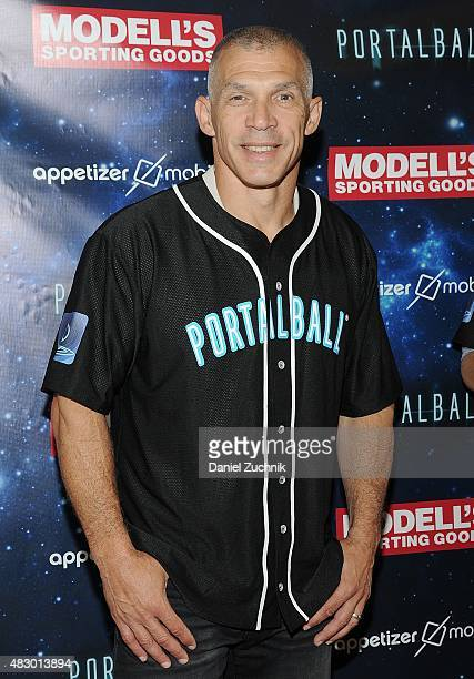 Yankees Manager Joe Girardi poses during the Portalball App Launch at Modell's Sporting Goods Store on August 5 2015 in New York City
