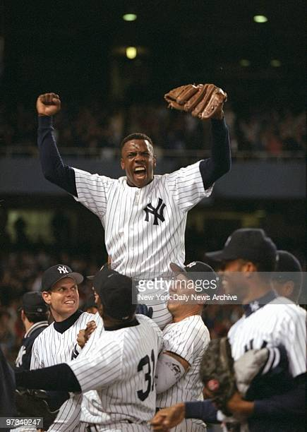 Yankees' pitcher Dwight Gooden is carried from the field by his teammates after pitching his first nohitter in game against the Seattle Mariners at...