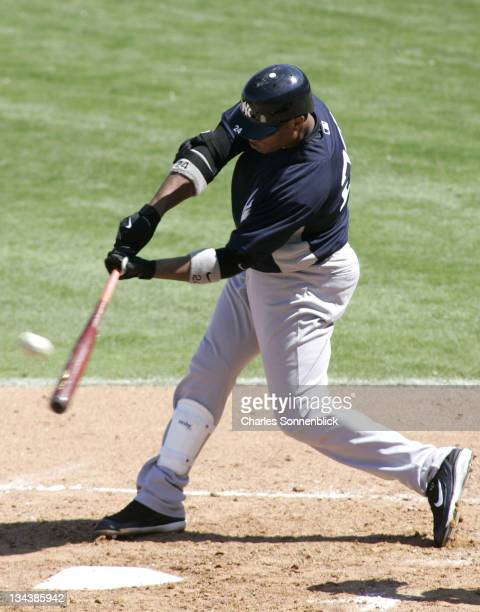 NY Yankees second baseman Robinson Cano connects with this pitch for a base hit versus the Philadelphia Phillies on March 4 2007 at Bright House...