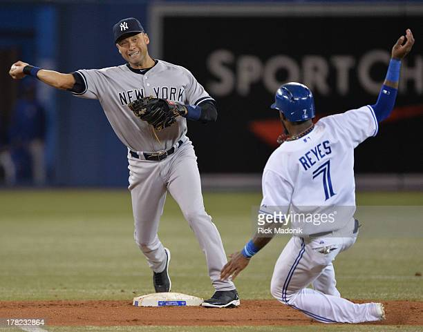 TORONTO ON AUGUST 27 Yankee's SS Derek Jeter turns a double play on Jose Reyes Toronto Blue Jays host New York Yankees at Roger's Centre in Toronto...