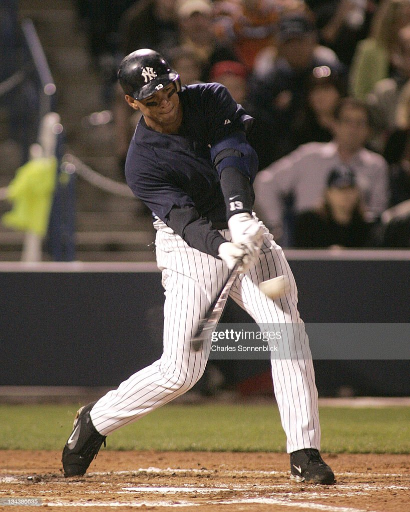 Yankees third baseman Alex Rodriguez hits a line drive for a double in a spring training game against the Reds on March 7 2007 at Legends Field in...