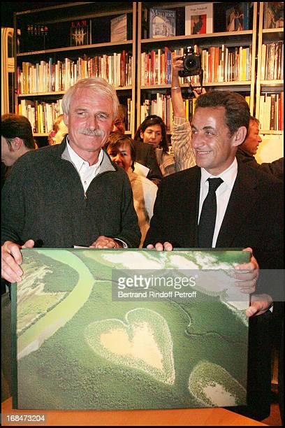 Yann Arthus Bertrand with wife and Nicolas Sarkozy at Yann Arthus Bertrand Signs Copies Of La Grande Terre At La Librairie Artcurial In Paris