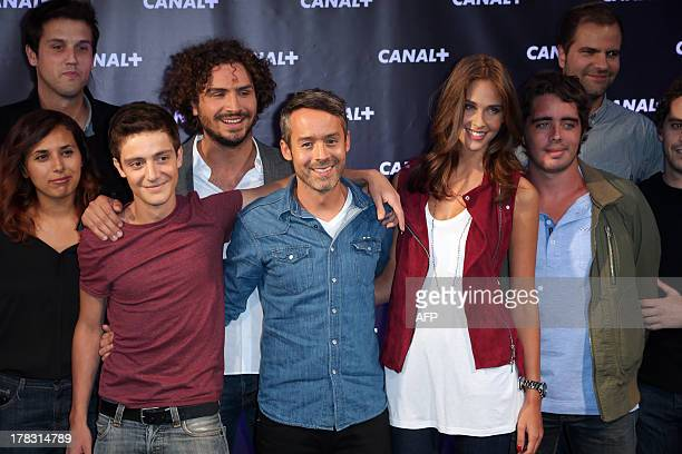 Yann Barthes with his team during a photocall for French TV Canal new season's launching evening on August 28 2013 in Paris AFP PHOTO / THOMAS SAMSON