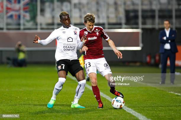 Yann Karamoh of Caen and Franck Signorino of Metz during the Ligue 1 match between Fc Metz and SM Caen at Stade SaintSymphorien on April 15 2017 in...