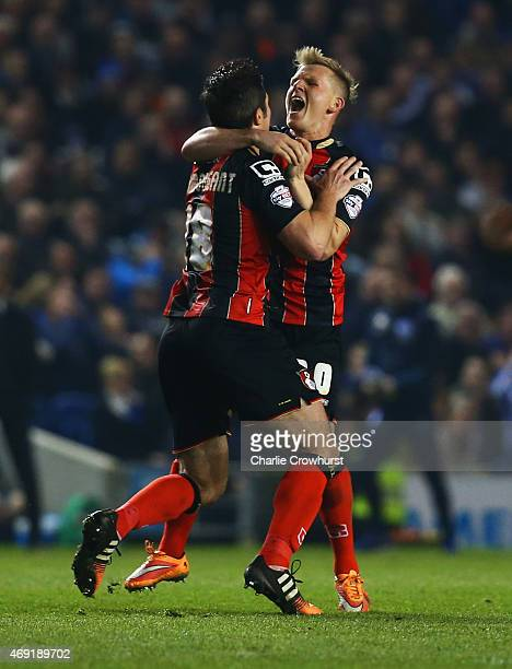 Yann Kermorgant of Bournemouth celebrates with Matt Ritchie as he scores their first goal from a free kick during the Sky Bet Championship match...