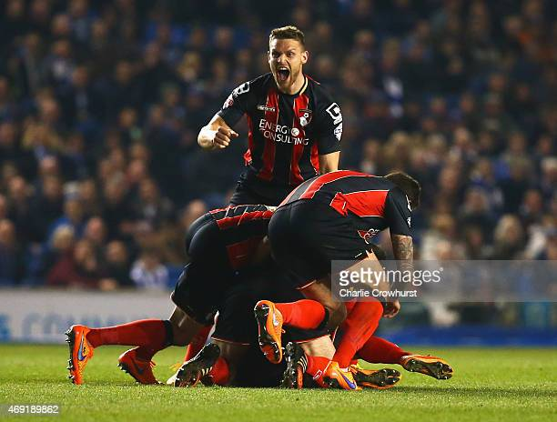 Yann Kermorgant of Bournemouth is mobbed by team mates in celebration as he scores their first goal from a free kick during the Sky Bet Championship...