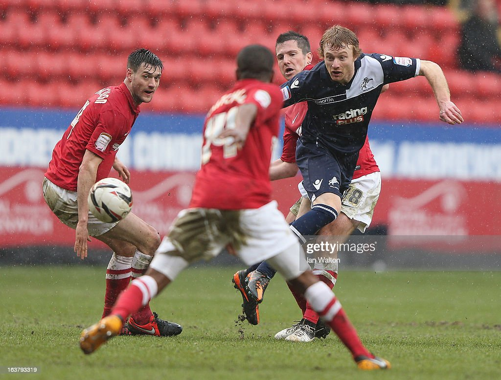 Yann Kermorgant (back) of Charlton Athletic tries to tackle Chris Taylor (R) of Millwall during the npower Championship match between Charlton Athletic and Millwall at The Valley on March 16, 2013 in London, England.