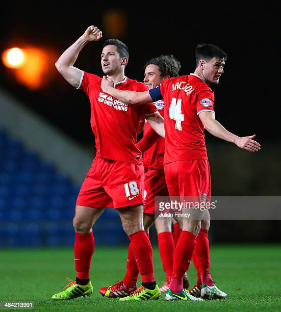 Yann Kermorgant of Charlton celebrates scoring their third goal with team mates during the FA Cup Third Round Replay match between Oxford United and...