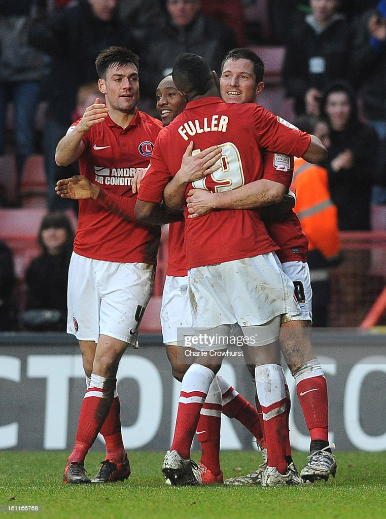 Yann Kermorgant of Charlton (R) celebrates with team mates after scoring the teams first goal during the npower Championship match between Charlton Athletic and Birmingham City at The Valley on February 09, 2013 in London England.