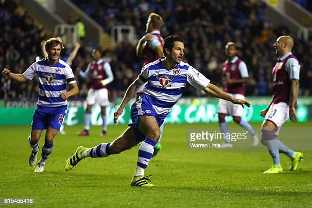 Yann Kermorgant of Reading celebrates scoring a goal off a rebounded penalty appempt during the Sky Bet Championship match between Reading and Aston...