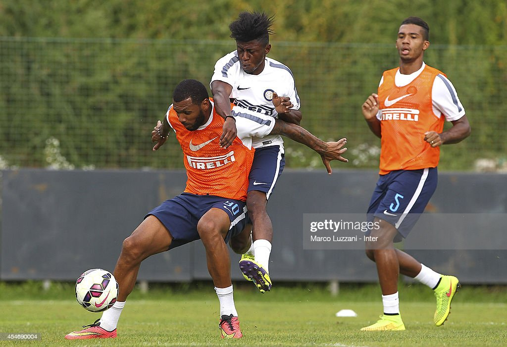 Yann M'Vila competes for the ball with Samuel Appiah during FC Internazionale training session at the club's training ground on September 5, 2014 in Appiano Gentile Como, Italy.