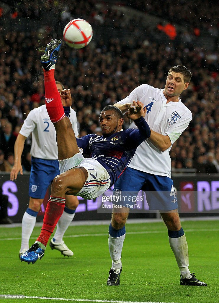 Yann M'Vila of France performs an overhead kick under pressure from Steven Gerrard of England during the international friendly match between England and France at Wembley Stadium on November 17, 2010 in London, England.