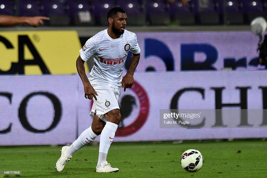 <a gi-track='captionPersonalityLinkClicked' href=/galleries/search?phrase=Yann+M%27Vila&family=editorial&specificpeople=6130765 ng-click='$event.stopPropagation()'>Yann M'Vila</a> of Inter in action during the Serie A match between ACF Fiorentina and FC Internazionale Milano at Stadio Artemio Franchi on October 5, 2014 in Florence, Italy.