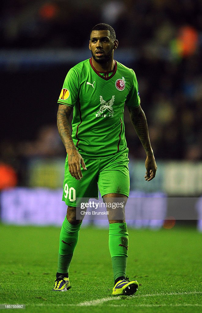 <a gi-track='captionPersonalityLinkClicked' href=/galleries/search?phrase=Yann+M%27Vila&family=editorial&specificpeople=6130765 ng-click='$event.stopPropagation()'>Yann M'Vila</a> of Rubin Kazan in action during the UEFA Europa League Group D match between Wigan Athletic and Rubin Kazan on October 24, 2013 in Wigan, England.